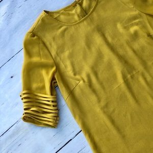 Naked Zebra mustard yellow boutique top